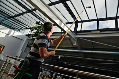 image of cleaning inside of office windows